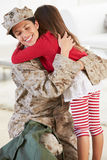 Daughter Greeting Military Mother Home On Leave Stock Image