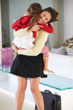 Daughter Greets Mother On Return From Work Royalty Free Stock Photos