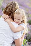 Daughter at the hands of the mother. Cute little daughter at the hands of the mother Royalty Free Stock Photos