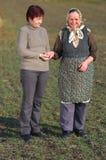 Daughter help elderly mother walk Royalty Free Stock Images