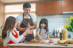 Daughter help parent preparing the bake Family concept. Daughter and parent preparing the bake Family concept stock photography