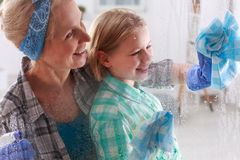 Daughter helping her mom. In cleaning at home Royalty Free Stock Images