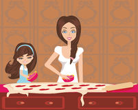 Daughter helping her mother bake cookies Royalty Free Stock Image