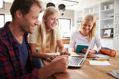 Daughter helping her parents with new technology Royalty Free Stock Photos