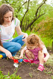 Daughter helping  mom in garden Royalty Free Stock Photography