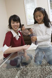 Daughter Helping Mother In Cleaning Table Royalty Free Stock Photos