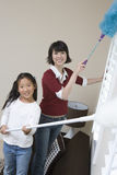 Daughter Helping Mother At Household Work Stock Photography