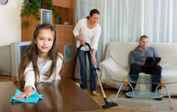 Daughter helping mother to clean Stock Photo