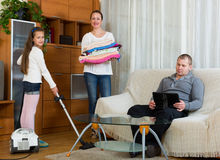 Daughter helping mother to clean Stock Photography