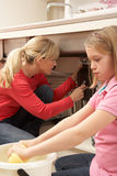 Daughter Helping Mother To Mop Up Leak Royalty Free Stock Image