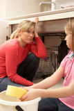 Daughter Helping Mother To Mop Up Leak Royalty Free Stock Photo