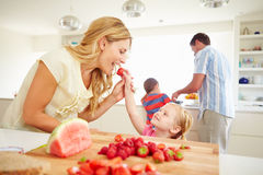 Daughter Helping Mother To Prepare Family Breakfast. Eating Strawberries Royalty Free Stock Images