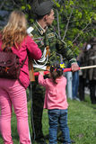 Daughter helps her father military officer to roll up a flag at Immortal regiment on 9 May, 2016 in Ulyanovsk, Russia Stock Photos