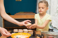 Daughter helps mum to prepare cupcakes. For Easter Stock Image