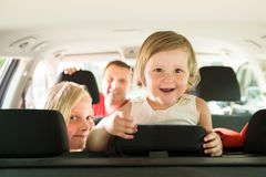 Daughter and her family traveling by car Royalty Free Stock Photos