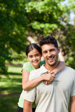 Daughter with her father in the park Royalty Free Stock Image