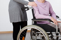 Daughter and her mom on wheelchair Stock Photo