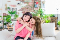Daughter with her mother stock photos