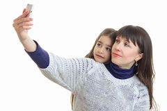 Daughter with her mother makes selfie Stock Images