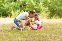 Daughter and her mother playing with their pets royalty free stock photo