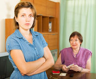 Daughter and her upset mother having financial problems Royalty Free Stock Images