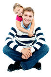 Daughter holding her father from behind Royalty Free Stock Images