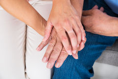 Daughter Holding Her Father`s Hand Stock Photo