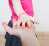 Daughter holding her palm in father's palm Royalty Free Stock Photos