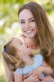 daughter holding mother outdoors smiling στοκ φωτογραφίες
