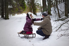 Daughter hug fatgher outdoors winter Royalty Free Stock Photography