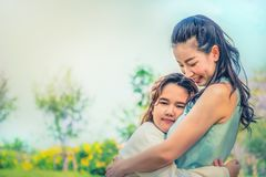 Daughter hug mother. With love in park royalty free stock images