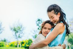 Daughter hug mother with love. In park royalty free stock photos