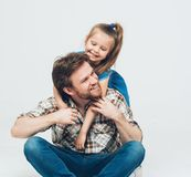 Daughter huge father studio portrait Stock Photo