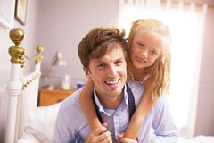 Daughter Hugging Father As He Gets Dressed For Work Royalty Free Stock Images