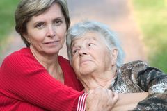 Daughter hugging her elderly mother. Stock Image