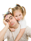 Daughter hugging her father Stock Images