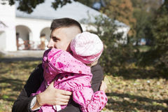 Daughter hugging her father Stock Photography