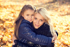 Daughter hugging her mother park Royalty Free Stock Images