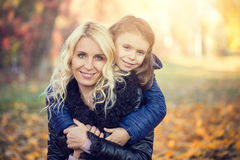 Daughter hugging her mother park Royalty Free Stock Photos