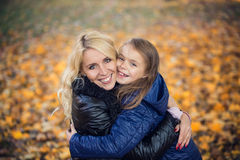 Daughter hugging her mother park Stock Photography