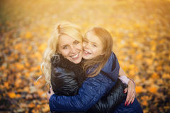Daughter hugging her mother park Stock Images