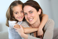 Daughter hugging her mother Royalty Free Stock Images