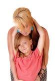 Daughter hugging mom. Stock Photo