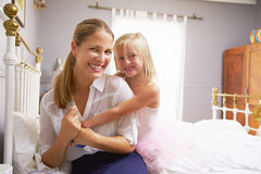 Daughter Hugging Mother As She Gets Dressed For Work Royalty Free Stock Photo