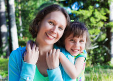 Daughter hugging mother. On a bright sunny day Stock Photos