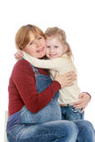 Daughter hugging pregnant mom Stock Photography