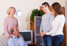 Daughter introducing  boyfriend to parents Stock Image