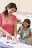 daughter ironing mother Στοκ Φωτογραφίες