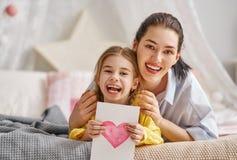 Free Daughter Is Congratulating Mom Stock Photos - 114150703