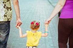 Daughter keeping her parents hands Royalty Free Stock Photo